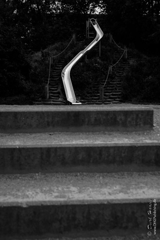 Slider in forced perspective - looking as if a person would hit stairs at the end