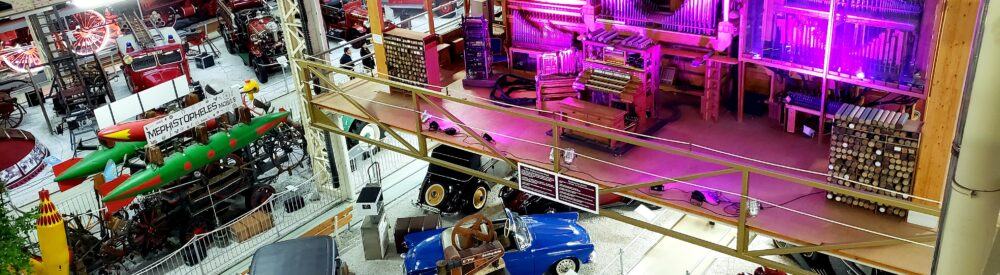 View of the organ and vintage cars from the 2nd floor of the Technik Museum Speyer