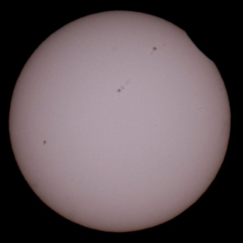 The Sun on May 21, 2012 at 06:18 Japanese time. The eclipse has just started. (c) Michael Khan, 2012