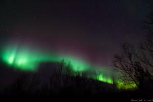 Farbenprächtige Aurora beim Aufstieg auf den Luossavaara