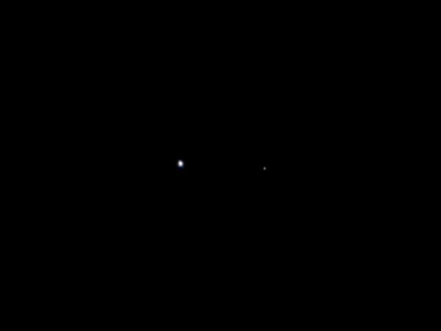 Erde und Mond aus 10 Millionen Kilometern Entfernung